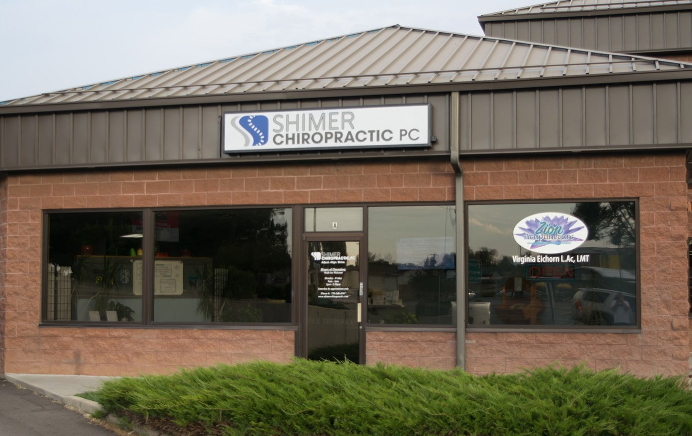 Front of Building at Reception Desk at Shimer Chiropractic in Longmont CO